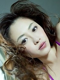 Anri Sugihara posing in purple lingerie her amazing big natural tits