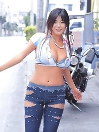 The amazing model Harumi Nemoto posing outdoors in a sexy outfit
