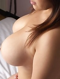 Busty asian Mitsuki An posing her natural big boobs