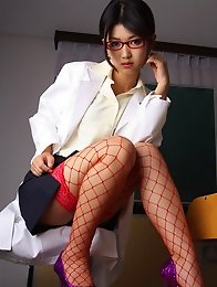 Sexy asian secretary in fish net stockings shows off her boobs