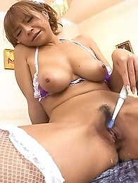 Sumire Matsu Asian plays with her big assets and sucks dildo